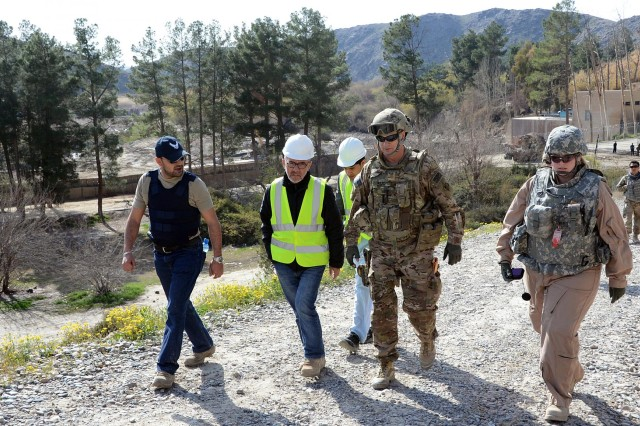 U.S. Army Corps of Engineers Kandahar Resident Office officer in charge Maj. Jeffery Ward, center, and Project Engineer Danielle Lovellette, right, talk to Bryan 77 contracting representatives about the project on their way up to the top of Dahla Dam. The Corps of Engineers is in Phase One of a two-phase construction plan that will ultimately raise the dam about 25 feet, boosting reservoir holding capacity and increasing water for irrigation and consumption for an estimated two million people. The project is expected to be completed in 2017.