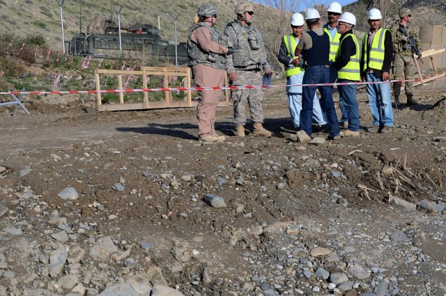 "U.S. Army Corps of engineers project Engineer Danielle Lovellette, left, and Construction Representative John ""Wojo"" Wojciechowski, discuss Dahla Dam Phase One construction with Bryan 77 contracting representatives. Bryan 77 is a joint venture between U.S.-based Bryan Construction and Turkish-based 77 Construction. The Corps of Engineers is expected to complete the two-phase construction plan in 2017. It will ultimately raise the dam about 25 feet, boosting reservoir holding capacity and increasing water for irrigation and consumption."