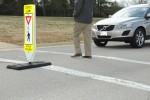 Signs warn motorists to be aware of crosswalk safety