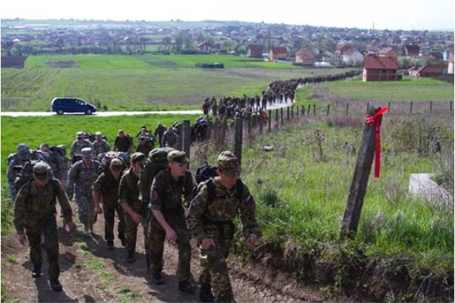 CAMP NOVO SELO, Kosovo -- Over 1,100 participants ruck along uneven terrain and steep hills during the Danish Contingency March at Camp Novo Selo, April 5. Proceeds from the march went to wounded Danish soldiers and veteran homes.