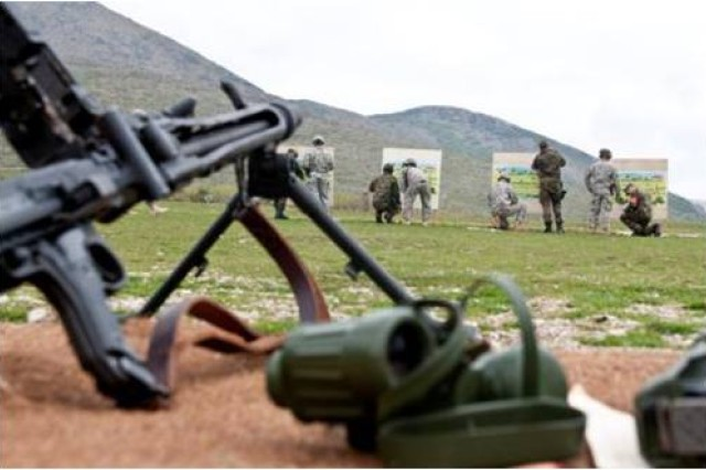 U.S. and German soldiers check targets after firing the MG3 machine gun during the German marksmanship range near Orahovac, Kosovo, April 7. The German army familiarized U.S. forces with the MG3 machine gun and the USP pistol, and served as coaches during the event.