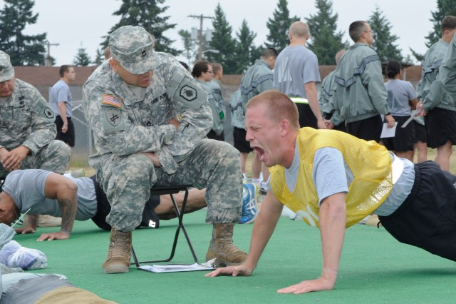 Army ROTC Cadets assigned to the 11th Regiment push themselves during the Army Physical Fitness Test's push-up event at the Leader Development and Assessment Course at Joint Base Lewis-McChord, Wash., in the summer of 2013. Starting this summer, Cadets will attend LDAC at Fort Knox, Ky.