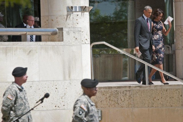 President Barack Obama and first lady Michelle Obama exit the III Corps headquarters building on Fort Hood to attend a memorial service for the three Soldiers killed in the April 2 shooting on the base, April 9, 2014. (U.S. Army photo by Sgt. Ken Scar, 7th Mobile Public Affairs Detachment)