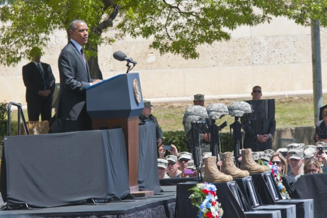 President Barack Obama speaks at a memorial service for Sgt. 1st Class Daniel M. Ferguson, Staff Sgt. Carlos A. Lazaney-Rodriguez, and Sgt. Timothy W. Owens, who were killed in the April 2 shooting tragedy on Fort Hood, April 9, 2014. (U.S. Army photo by Sgt. Ken Scar, 7th Mobile Public Affairs Detachment)