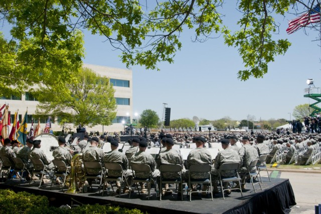 President Barack Obama speaks at a memorial service held in front of the III Corps Headquarters building for Sgt. 1st Class Daniel M. Ferguson, Staff Sgt. Carlos A. Lazaney-Rodriguez, and Sgt. Timothy W. Owens, who were killed in the April 2 shooting tragedy on Fort Hood, April 9, 2014. (U.S. Army photo by Sgt. Ken Scar, 7th Mobile Public Affairs Detachment)