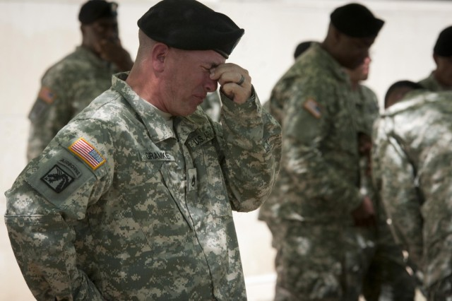 Staff Sgt. Jerry Gramke, who is with the 49th Transportation Movement Control Battalion, 4th Sustainment Brigade, loses his composure after taking part in the traditional roll call for the fallen portion of a memorial service for Sgt. 1st Class Daniel M. Ferguson (who was a transportation supervisor for the 49th), Staff Sgt. Carlos A. Lazaney-Rodriguez, and Sgt. Timothy W. Owens, April 9, 2014. All three Soldiers were killed in the April 2 shooting tragedy on Fort Hood. (U.S. Army photo by Sgt. Ken Scar, 7th Mobile Public Affairs Detachment)