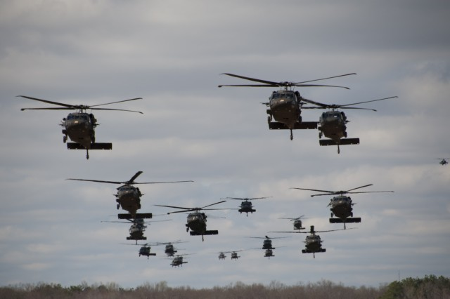 "Twenty one UH-60 Black Hawk helicopters from 5th Battalion, 101st Combat Aviation Brigade ""Wings of Destiny,"" 101st Airborne Division (Air Assault), carry Soldiers from 3rd Battalion, 187th Infantry Regiment, 3rd Brigade Combat Team ""Rakkasans,"" into Landing Zone Red Crow on Fort Campbell, Ky., during Operation Golden Eagle, April 8, 2014. The four-day exercise was the first brigade-size air assault operation conducted by the 101st Airborne Division in more than a decade, and featured Soldiers from 3rd Brigade Combat Team and 101st Combat Aviation Brigade moving more than 1,100 Soldiers and sling-loading more than 20 pieces of equipment."