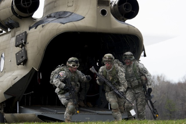 "Soldiers with 3rd Battalion, 320th Field Artillery Regiment, 3rd Brigade Combat Team ""Rakkasans,"" 101st Airborne Division (Air Assault), secure a landing zone during the full dress rehearsal for Operation Golden Eagle at Fort Campbell, Ky., April 4, 2014. The four-day exercise was the first brigade-size air assault operation conducted by the 101st Airborne Division in more than a decade, and featured Soldiers from 3rd Brigade Combat Team and 101st Combat Aviation Brigade moving more than 1,100 Soldiers and sling-loading more than 20 pieces of equipment."