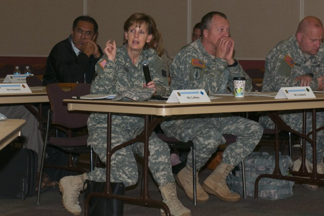 Maj. Gen. Karen Ledoux, commander 88th Regional Support Command, engages 80th Training Command (TASS) leadership (not pictured) during a One Army School System Concept Plan strategy session with 80th TC subordinate command leaders and representatives of the U.S. Army Reserve's four regional support commands at the 80th TC headquarters, Richmond Va., April 4, 2014. Right of Ledoux:  Brig. Gen. William Gothard, deputy commander 81st RSC (center) and Col. Joseph Roberts, director of public works, 81st RSC.