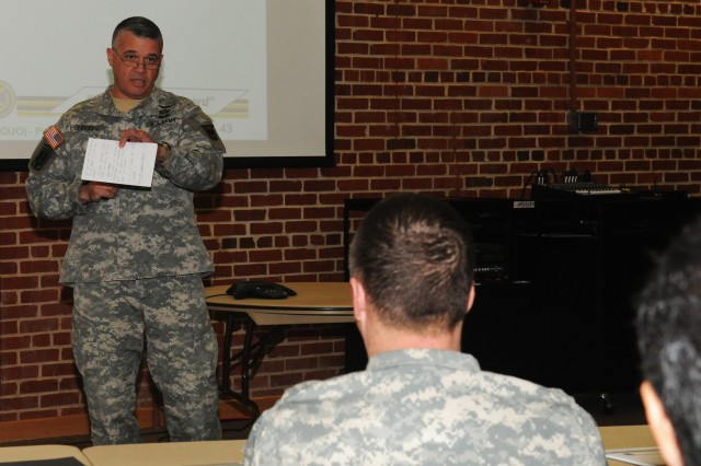 Brig. Gen. Richard Torres, 80th Training Command deputy commander addresses representatives of the U.S. Army Reserve's four regional support commands and 80th TC subordinate command leaders during  a One Army School System Concept Plan strategy session at the 80th TC headquarters, Richmond Va., April 4, 2014.