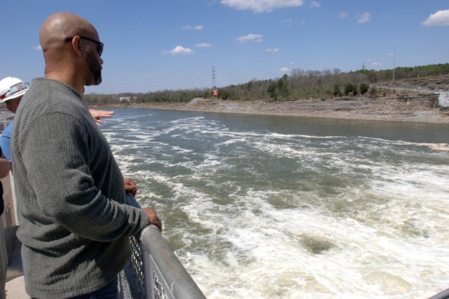 Richard Flood, a hazard mitigation specialist with the Federal Emergency Management Agency Region 4 Mitigation Division, watches turbulent waters below Old Hickory Dam while touring the project during a Silver Jackets meeting April 9, 2014. (USACE photo by Leon Roberts)
