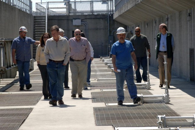 Dirk Cundiff (left) and Chris Sherek (third from right) lead a U.S. Army Corps of Engineers Nashville District tour of the Old Hickory Hydropower Plant for local, state and federal participants of a Silver Jackets meeting at Old Hickory Dam in Old Hickory, Tenn., April 9, 2014. The hydropower plant is located on the Hendersonville, Tenn., side of the Cumberland River. Silver Jackets is a program that promotes cohesive solutions and synchronizes plans and programs between local, state and federal agencies. (USACE photo by Leon Roberts)