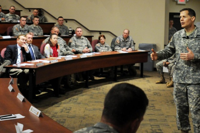 Lt. Gen. Jeffrey W. Talley, the chief of the U.S. Army Reserve and the commanding general of the U.S. Army Reserve Command, addresses more than 250 Soldiers during a town hall meeting at the 88th Regional Support Headquarters on Fort McCoy, Wis., April 10, 2014.