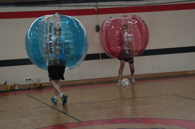 Service members face off during a bubble soccer match April 3 at the Kleber Kaserne Gym. The bubble suits will be used in an upcoming soccer tournament, which is part of a summer long campaign geared toward readiness and resiliency.