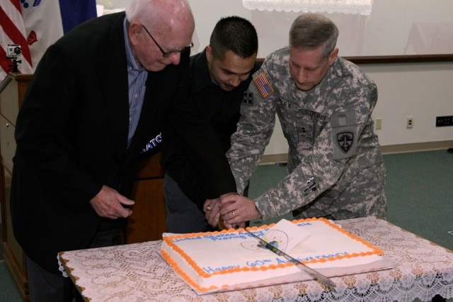 From left, Rob Reiner, former Electronic Proving Ground technical director, Eddie Flores, EPG's youngest employee, and Maj. Gen. Peter Utley, commanding general, U.S. Army Test and Evaluation Command, cut the cake during the EPG 60th Anniversary ceremony on Tuesday at the Intelligence Systems Integration Laboratory.