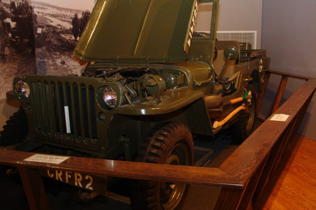 A Finance Corps Museum exhibit displays an Army jeep representing finance officers' transportation in World War II.