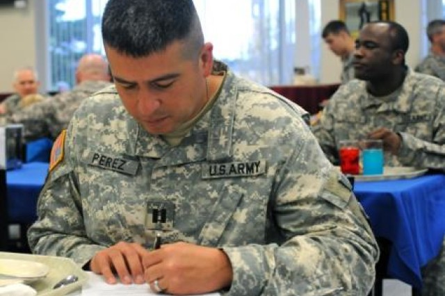 U.S. Army Capt. Jose Perez of Houston, signs the Sexual Harassment Assault Response and Prevention pledge at the SHARP Pancake Breakfast held at Fort Polk�'s Patriot Inn, April 3, 2014. The breakfast was held in observance of Sexual Assault Awareness Month. Perez serves as commander, Forward Support Company F, 2nd Battalion, 30th Infantry Regiment, 4th Brigade Combat Team, 10th Mountain Division. (U.S. Army photo by Sgt. David Edge, 4th BCT, 10th Mtn. Div. Public Affairs)