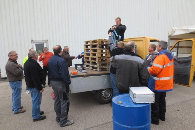 As part of his training April 10, Andreas Gackstatter, on truck, a mason with the U.S. Army Garrison Ansbach Directorate of Public Works, demonstrates how to properly secure a stack of pallets on a flatbed truck. USAG Ansbach held a load securement class April 8 through 10 to train vehicle operators and equipment loaders on how to properly contain, immobilize and secure cargo.