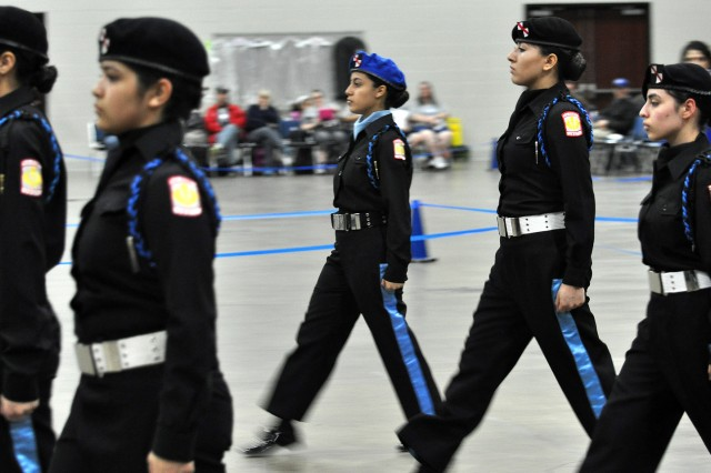 "JROTC Cadet Amanda Valencia (center) from Hubbard High School, Chicago, leads the Hubbard ""Blacksheep"" during unarmed exhibition at the Army JROTC National Drill Classic in Louisville, Ky., April 5"