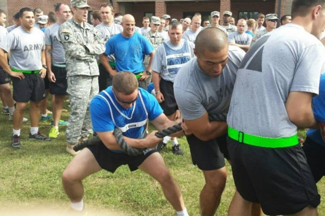 Capt. Donald Bigham (blue) competes in a tug of war competition with his Soldiers. Bigham is leaving 3rd Armored Brigade Combat Team, 3rd Infantry Division, to take a position as a Master Fitness Trainer instructor at Fort Jackson, S.C.
