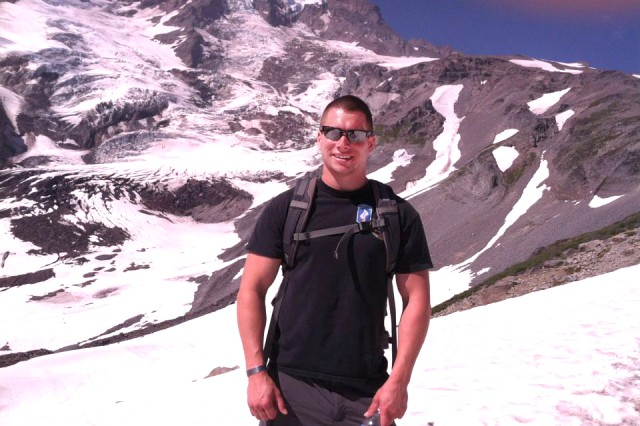 Spc. Kyle White poses for a photo while hiking Mt. Ranier, Wash., during a family outing, in Summer 2012.