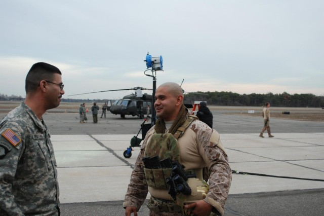 "New York Army National Guard Sgt. Dennis Raffanelo and Sgt. Herbert Gomezmaldonado, both members of the 1st Battalion, 69th Infantry, on the set at Republic Airport in East Farmingdale, N.Y., during the filming of scenes for the Universal Television TV show ""State of Affairs."" Gomezmaldonado portrayed a Navy SEAL in the TV show, while Raffanelo drove a Humvee used to dress the set during the production."