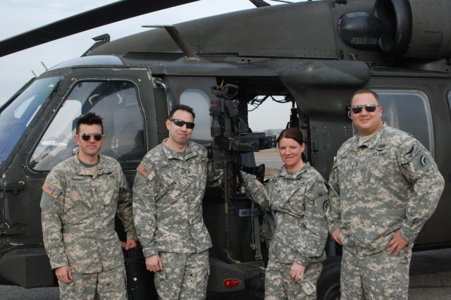 "These four members of the New York Army National Guard's 3rd Battalion, 142nd Aviation, flew a UH-60 Black Hawk helicopter used in filming the Universal Television TV show ""State of Affairs,"" during shooting at Republic Airport in East Farmingdale, N.Y., April 3, 2014. (From left) Warrant Officer 1 John Seeger, Sgt. Matt Cordaro, Staff Sgt. Amy Klemm and Chief Warrant Officer 3 Robert Hansen."