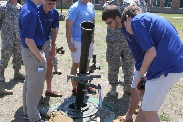 Soldiers from 3rd Battalion, 7th Infantry Regiment, 4th Infantry Brigade Combat Team, 3rd Infantry Division field questions from United Community Bank's Junior Board of Directors about the M252 mortar system during a tour of Fort Stewart, Ga., April 9, 2014.  (U.S. Army Photo by Sgt. Bob Yarbrough, 4th IBCT, 3rd ID, Public Affairs)