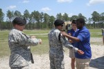 Cottonbalers teach high school students about Soldier life