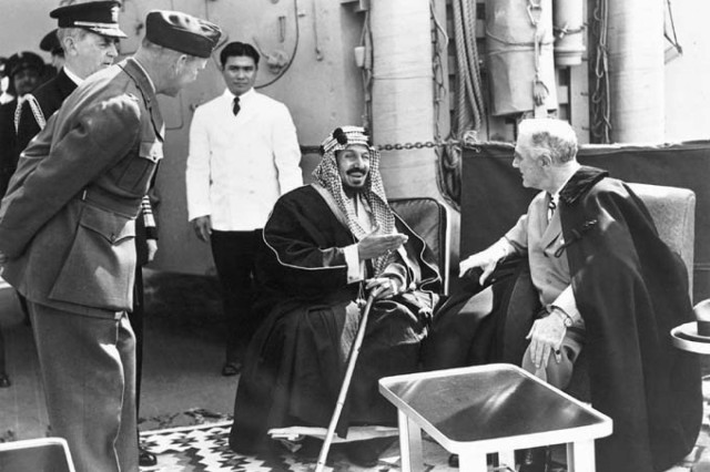 King Abdul Aziz of Saudi Arabia meets President Franklin D. Roosevelt aboard the USS Quincy Feb. 14, 1945.