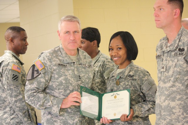 Maj. Gen. Mike Murray, 3rd ID commanding general, poses for a photo with Staff Sgt. Dianna L. Royal after awarding her an Army Commendation Medal for her efforts that led to Fort Stewart being declared the culinary installation of the year. For the second time in three years, 3rd Infantry Division Soldiers took top honors as the culinary team of the year at the Annual Military Culinary Arts Competition held at Fort Lee, Virginia in March.