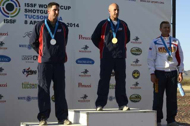 The winners of the Men's Double Trap stand proudly on the podium after being presented their medals. Staff Sgt. Josh Richmond (left) took home silver while Staff Sgt. Jeff Holguin (center) won a gold medal at the International Shooting Sports Federation Shotgun World Cup, April 13, 2014, in Tucson, Ariz.
