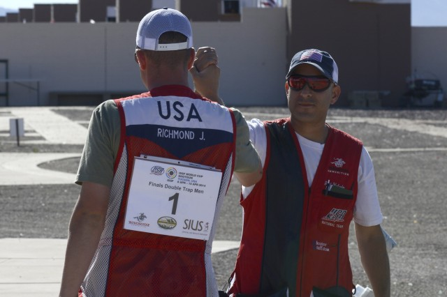 Staff Sgt. Josh Richmond and Staff Sgt. Jeff Holguin, both with the U.S. Army Marksmanship Unit, congratulate each other on their victory during the 2014 International Shooting Sports Federation Shotgun World Cup, April 13, 2014, in Tucson, Ariz. Holguin took home the gold after winning the shoot off after the two USAMU shooters tied with 27 hits each.