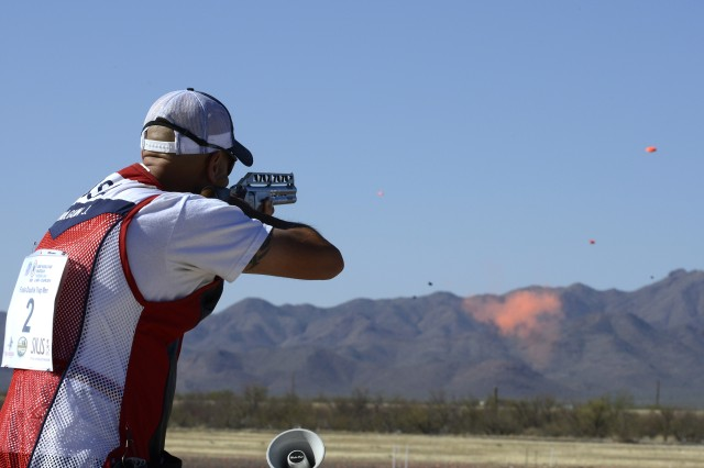 Staff Sgt. Jeff Holguin, U.S. Army Marksmanship Unit Shotgun Team, nails his target during the gold medal shoot off for Men's Double Trap during the 2014 International Shooting Sports Federation Shotgun World Cup, April 13, 2014, in Tucson, Ariz. Holguin squared off against fellow USAMU member Staff Sgt. Josh Richmond to win the gold medal.