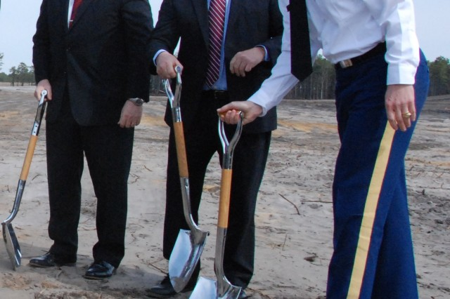 CERDEC I2WD Director Henry Muller, NJ Fourth District Congressman Chris Smith and Army Corps of Engineer- New York District Commander COL Paul Owen break ground at the CERDEC Flight Activity Hangar groundbreaking ceremony at Joint Base McGuire-Dix-Lakehurst April 11. The CERDEC research and development hangar is scheduled to be completed early 2016 and will enable CERDEC to continue its C4ISR advancements as related to aircraft. (U.S. Army Photo by Mike Burke)