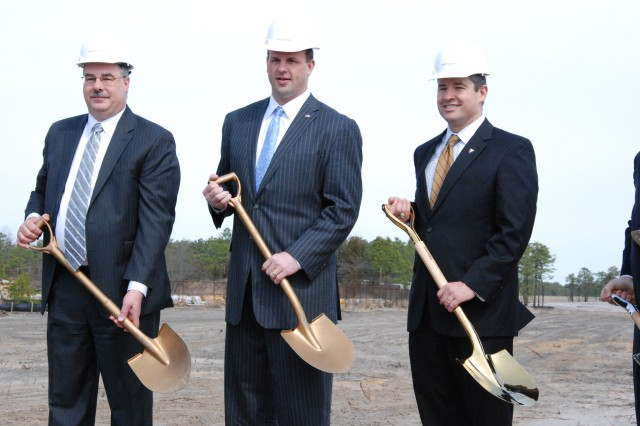 CERDEC Associate Director Robert Zanzalari, NJ Third District Congressman Jon Runyan and RDECOM Director Dale Ormond break ground at the CERDEC Flight Activity Hangar groundbreaking ceremony at Joint Base McGuire-Dix-Lakehurst April 11. The CERDEC research and development hangar is scheduled to be completed early 2016 and will enable CERDEC to continue its C4ISR advancements as related to aircraft. (U.S. Army Photo by Mike Burke)