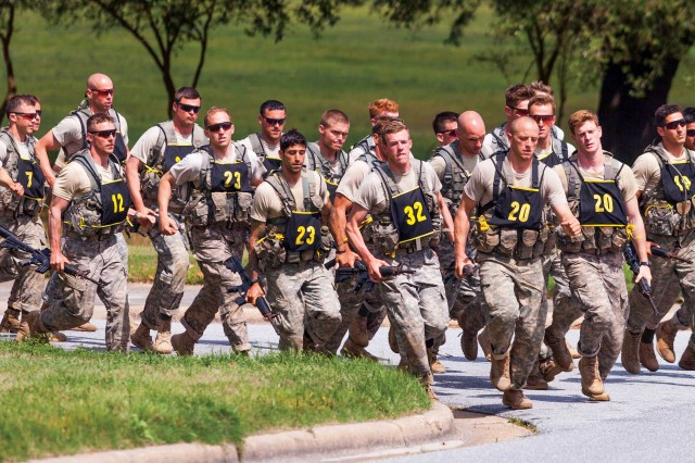 Competitors in the 2014 Best Ranger Competition head toward the finish line during the final buddy run Sunday. This three-day competition started with 50 two-man teams and ended with 26 still standing.