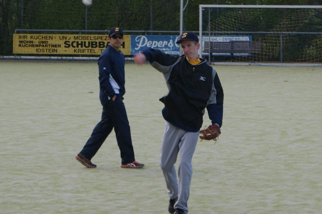 Assistant coach Lawrence Carabajal watches as Paul Wenzel, a third baseman and pitcher for the Hünstetten Storm -- a German youth team in the 13-15 age division -- warms up before practice April 14. Carabajal works as a structural engineer for U.S. Army Corps of Engineers Europe District but is returning for his third season with the local baseball club.