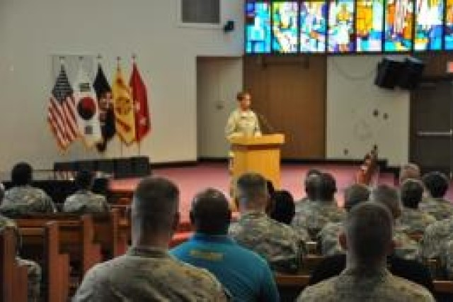 Capt. Cindy Williams, SHARP program SARC for 501st Military Intelligence Brigade, captures the attention of the audience by sharing her story during the official kick-off event at the South Post Chapel, March 31. (U.S. Army photo by Pfc. Moon Hyungju)