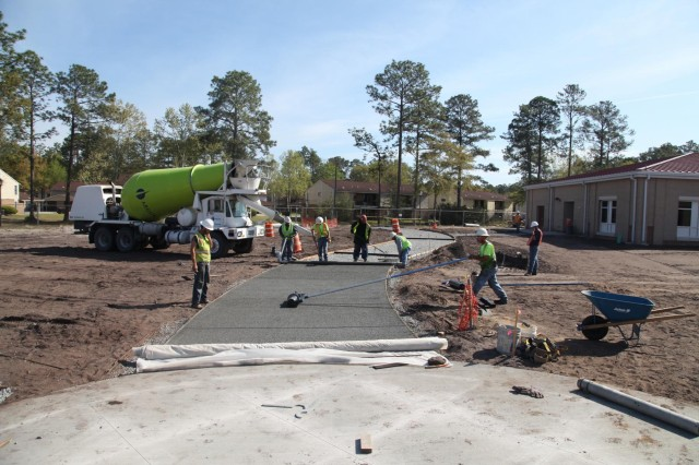Workers build sidewalks at the new Murray Elementary School using environmentally sustainable pervious material. The sidewalks will allows water to pass directly through them, thus reducing runoff from the site and allowing groundwater to recharge.