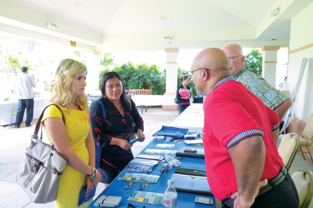 Ashlyn Dickson (left) and Cherry Whitley network with representatives from Lockheed Martin at the Military Spouse Career Forum and Fair, hosted by the ACS ERP at SB, last April. This year's event takes place at the Nehelani, April 25.
