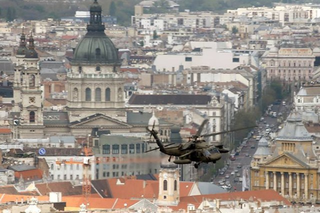 A UH-60 Black Hawk helicopter from U.S. Army Europe's 12th Combat Aviation Brigade cruises over Budapest in this courtesy image from the U.S. embassy in the Hungarian capital. 12th CAB Soldiers and aircraft are in Hungary training with Hungarian and Dutch forces during exercise Saker Falcon.