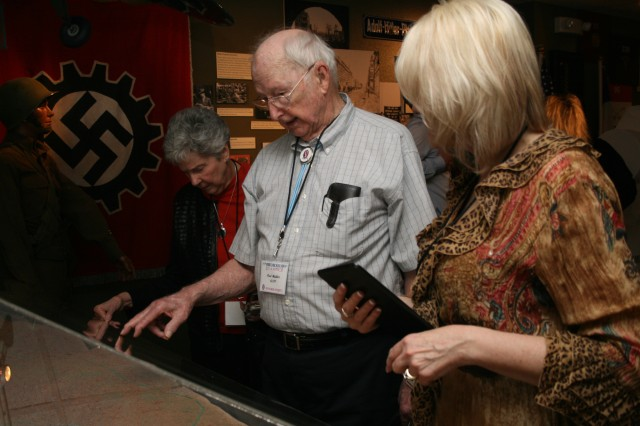 Paul Madden of Shreveport, La., looks at an exhibit in the 95th Training Division Memorial in the Armed Forces Reserve Center at Fort Sill. A rededication ceremony, April 11, 2014, marked the opening of the memorial. It was moved from Oklahoma City to Fort Sill following the relocation of the 95th Training Division headquarters.