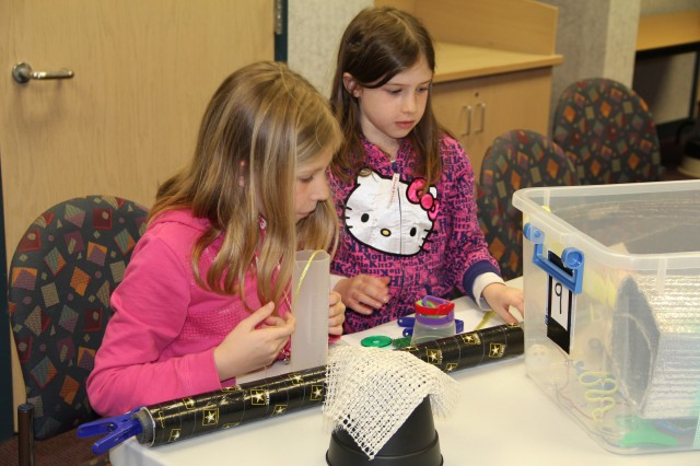 "Students build a non-working prototype of a ""super technology"" at a workshop lead by the Communications-Electronics Research, Development and Engineering Center to engage girls in STEM at the Edgewood Public Library, April 15."