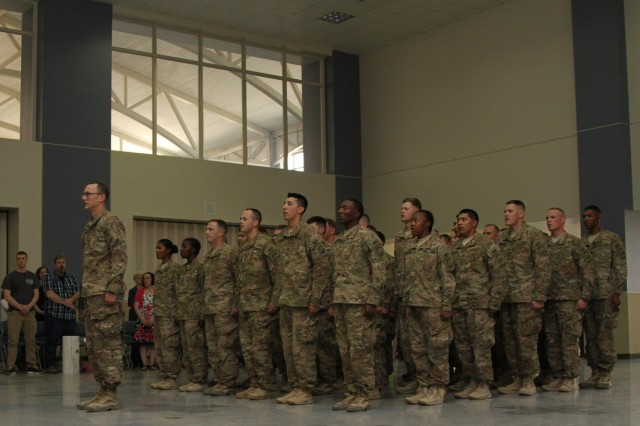 "Soldiers with the 551st Military Police Company ""Hooligans,"" 716th Military Police Battalion, 101st Sustainment Brigade ""Lifeliners,"" 101st Airborne Division (Air Assault), stand at attention during a welcome home ceremony April 10, at Fort Campbell. The Hooligans were deployed in Afghanistan for nine months where they proudly served their country with honor conducting customs missions. (U.S. Army photo by Sgt. Sinthia Rosario, 101st Sustainment Brigade Public Affairs)"