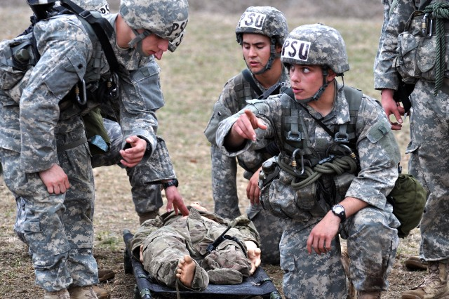 """Cadets from Penn State University prepare to carry a """"wounded soldier"""" to an evacuation point, during the 2014 Sandhurst Competition held April 11-12, 2014, at the U.S. Military Academy at West Point, N.Y."""