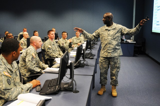 CW4 Malachi Simmons, an academic facilitator and instructor at the Warrant Officer Career College, leads a classroom discussion on military operations April 10 at Kliev Hall.