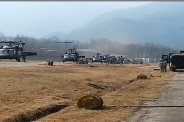 Soldiers from Company E, 2nd Battalion (Assault), 2nd Aviation Regiment, establish a 10 point forward area refueling point for all helicopters involved in the 2-2 Avn. Regt. Republic of Korea/ Marine air assault, March 13, 2014 in South Korea. (Photo courtesy of Christopher Bodin)