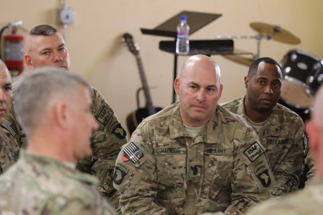 NANGARHAR PROVINCE, Afghanistan -- Command Sgt. Maj, Brandon Haywood, the senior enlisted Soldier with 2nd Brigade Combat Team, 101st Airborne Divison, listens to Sgt. Maj. of the Army Raymond Chandler III during a town hall meeting at Forward Operating Base Fenty in Nangarhar province, Afghanistan, April 15, 2014. Chandler visited deployed personnel from 2nd Brigade Combat Team and 159th Combat Aviation Brigade both with 101st Airborne Division. (U.S. Army photo by Sgt. David Cox, 2nd Brigade Combat Team, 101st Airborne Division)
