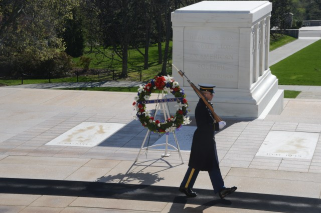 A Tomb Sentinel guards the Tomb of the Unknown Soldier following an Army Full Honors Wreath laying ceremony at the Tomb of the Unknown Soldier at Arlington National Cemetery, Va., April 16, 2014.